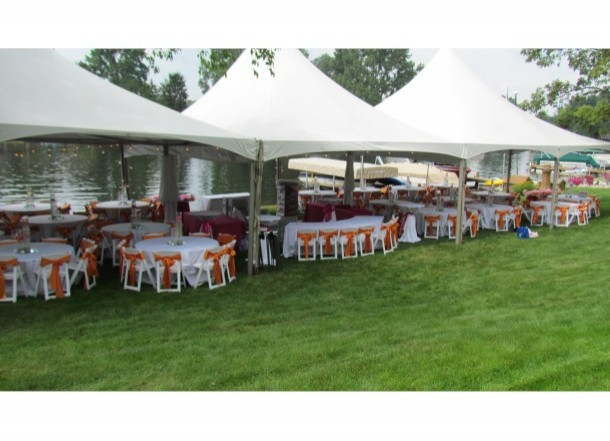 White Padded Folding Chairs with Orange Sash